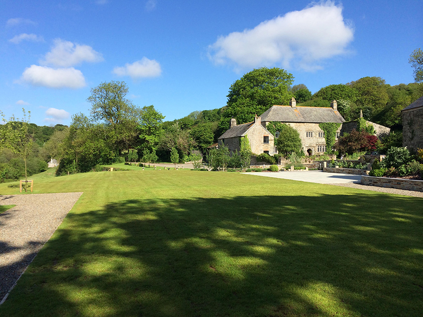 View across the marquee garden lawn at wedding venue Pengenna Manor in Cornwall.jpg
