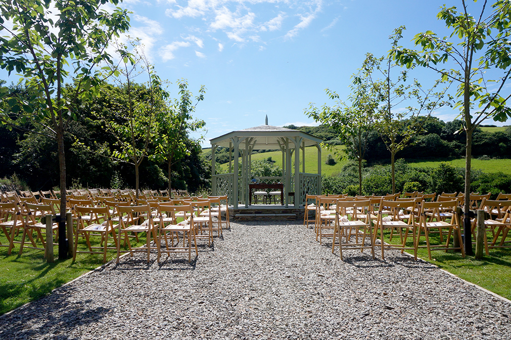 Outdoor wedding ceremony setup at the summerhouse at wedding venue Pengenna Manor in Cornwall.jpg