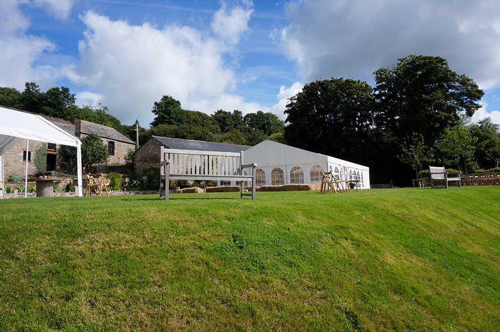Steel frame marquee on the garden lawn at wedding venue Pengenna Manor in Cornwall.jpg