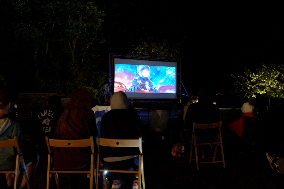 Outdoor open air cinema event Big Hero 6 at Pengenna Manor event venue in Cornwall 02.jpg