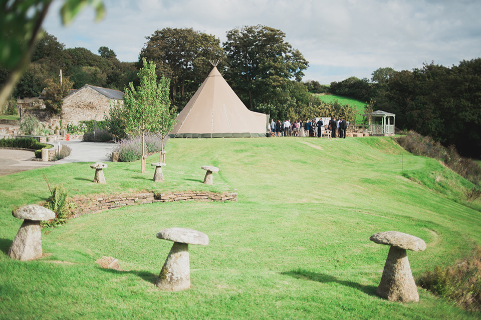 Giant tipi marquee on the garden lawn at wedding venue Pengenna Manor in Cornwall.jpg
