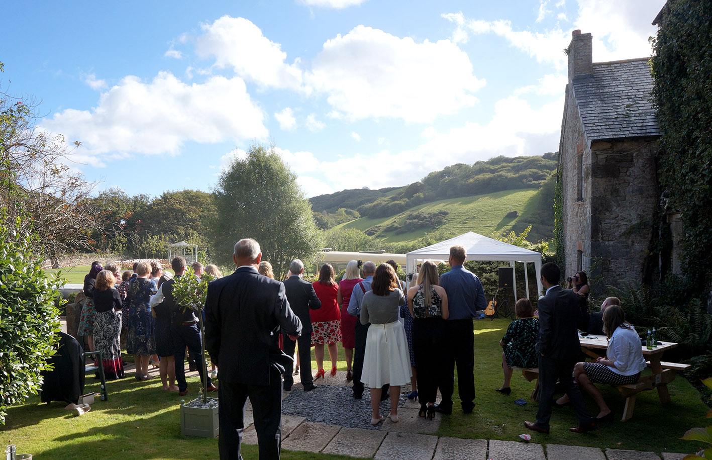 Drinks on the front lawn of Pengenna Manor Cornwall wedding venue.jpg