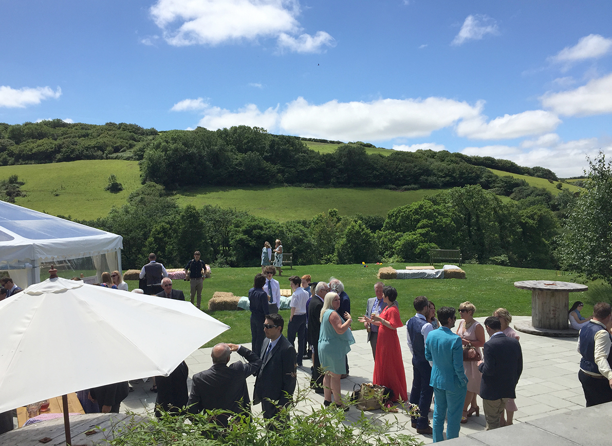 Drinks on the marquee garden patio of Pengenna Manor Cornwall wedding venue.JPG