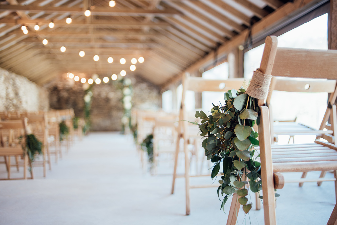 The inside of the Cowyard Barn rustic party and reception space set for a wedding ceremony at Pengenna Manor Cornwall wedding venue02.jpg
