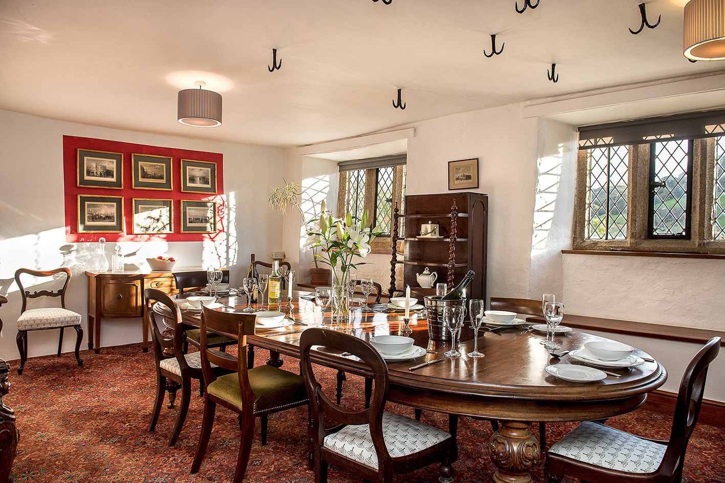 Luxurious dining room in the Medieval wing at Cornwall wedding venue Pengenna Manor.jpg