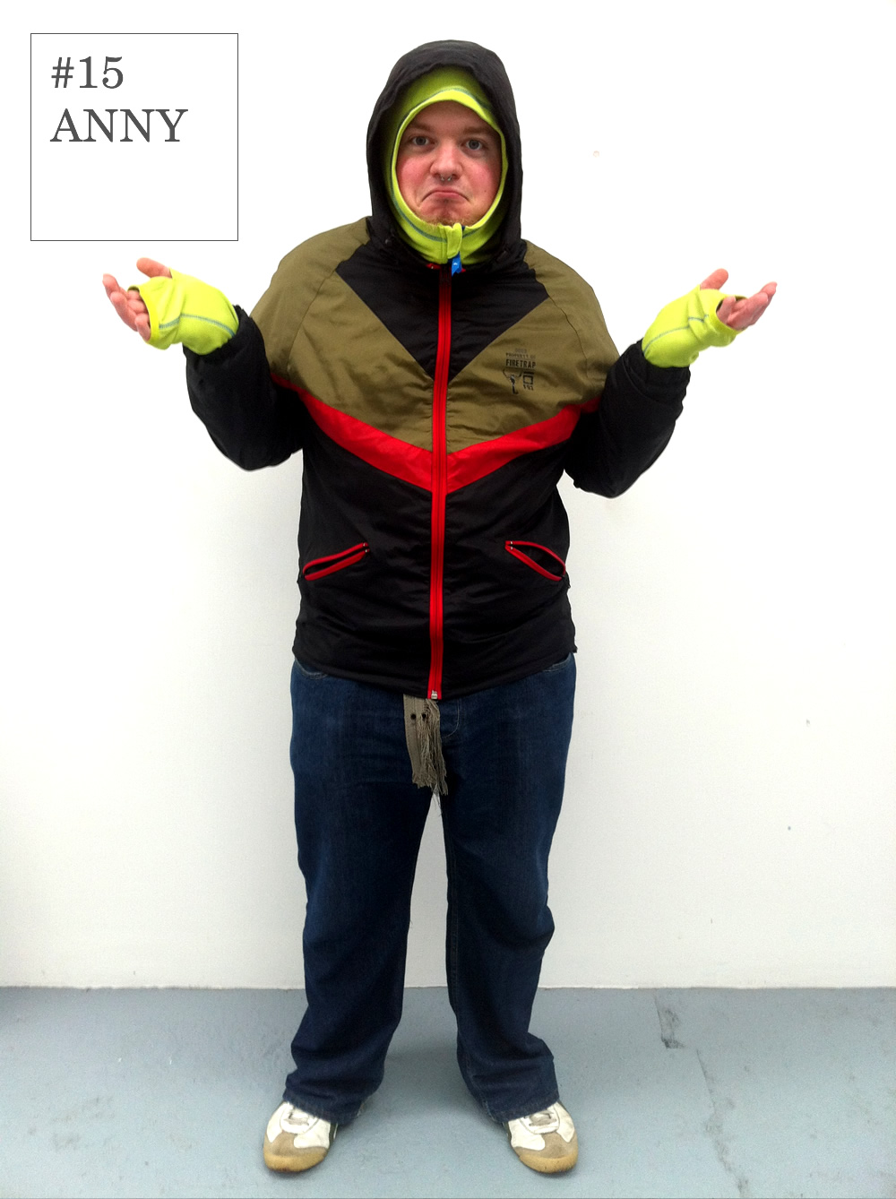 """Anny's layered outfit shows that he's always prepared for any weather condition he may encounter on his journey to Folk.    A flash of neon,nonchalant expression and casual stance say """"What?…it's only rain.""""    Jacket: Firetrap     Top: Quiksilver     Jeans: FCUK     Shoes: Onitsuka Tiger"""