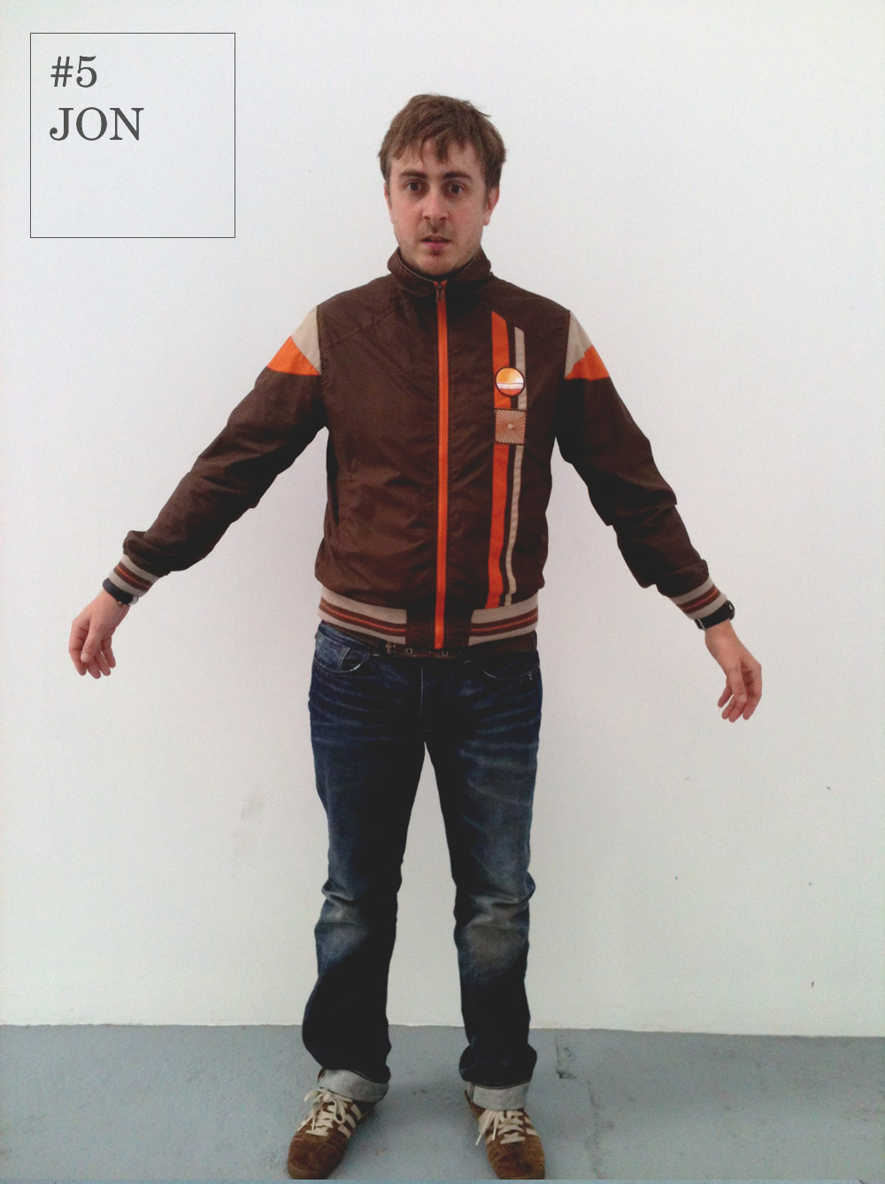 For Jon's secondappearanceon the Fash Off, he shows us his take on a 90's inspired look.   Showing off his outfit in his signature stance, he models a playful palette of chocolate orange shades. Coupled with a classic pair of denim jeans, Jon let's his jacket do all the talking.   Some would say this look is stuck in the past, others would say Jon is ahead of his time.    We'll let you decide…      Jacket: Burton      Jeans : Flying Horse     Shoes : Adidas Chile '62