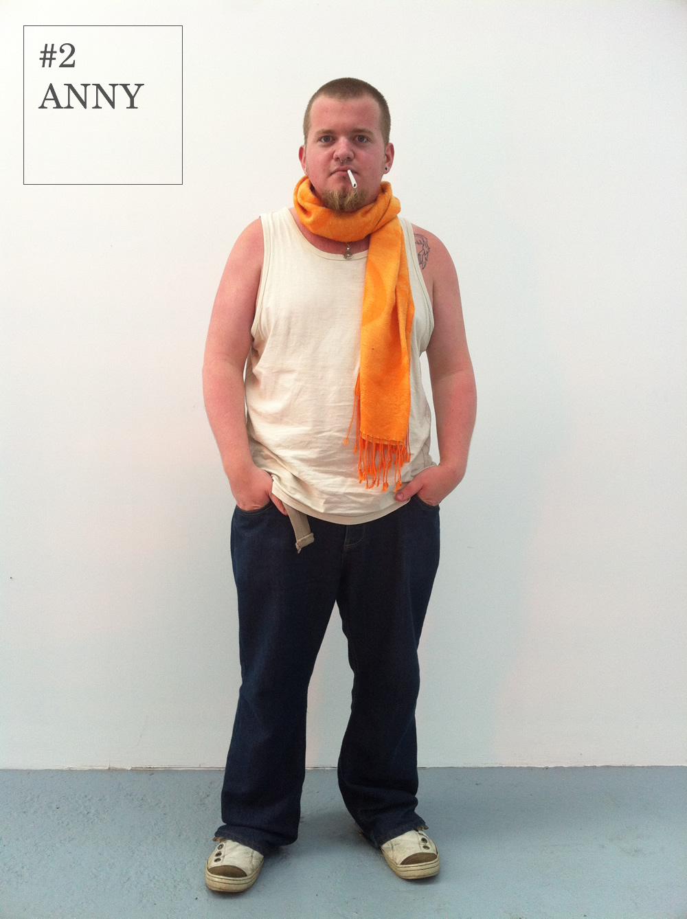 Anny demonstrates how one item can instantly put a new spin on the everyday capsule wardrobe.   He layers a simple saffron scarf (an appropriately autumnal shade) over a staple jeans and vest combo instantly bringing the vibrant style of Amsterdam to the sleepy shores of Dorset.      Vest: Mantaray         Jeans: FCUK         Shoes: Fly London      Scarf : Amsterdam market stall                  (All facial accesories from Paradox, Bournemouth)