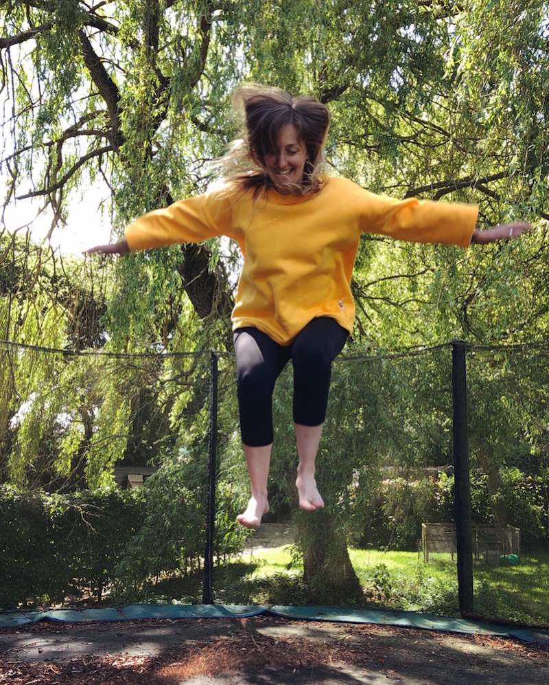 Happiness is a trampoline and bright yellow  @aesthetic_laundry  jumper!