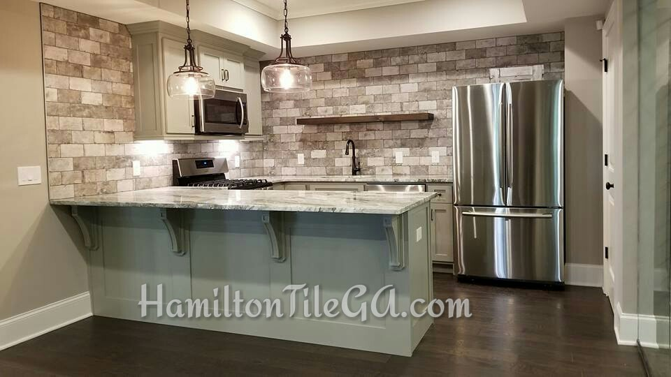 Hamilton Tile is your go to for back splash installations. Spectacular taste from these folks located in Milton, GA.  Click here to learn how the positioning of your under cabinet lighting can make or break the over all look of your back splash.
