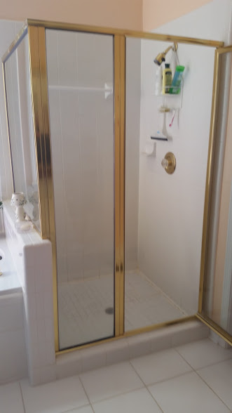 The original shower...The shower door didn't open correctly, the pan was holding water creating a swamp inside Eileen's pristine home!
