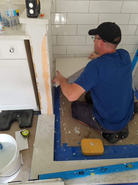 Here's Jason installing a custom corner seat. Your best option is a hard surface top.