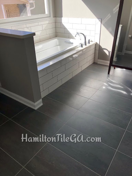 """Ended up having to straight set this tile because these 12""""x24"""" tile were so brutally warped, no way an offset would work out, lips would be noticeable. This customer trusted our expertise and we were able to set these straight set and get a nice, flat floor. To be frank, our finished product depends on the material we get. There's ways to disguise imperfections in material, but we need your trust and confidence to utilize our skill and experience. We will always have your best interest in mind."""
