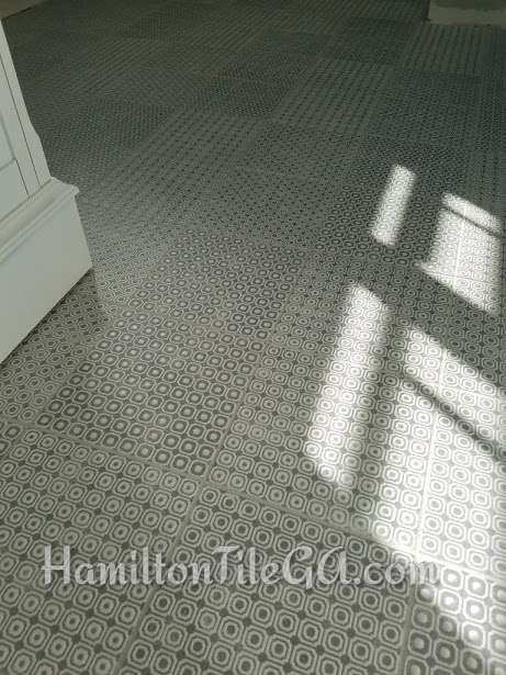 This patterned tile floor in Milton, GA is so great because it is also textured. Very neat.