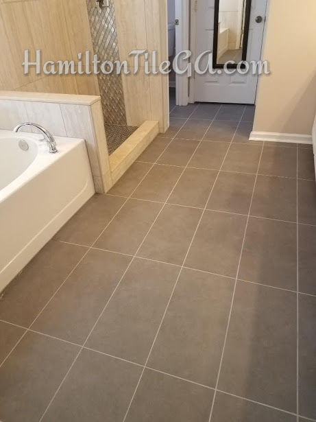 The shower leaked and this persons insurance company paid for the bathroom floor. Not bad, all things considered. Straight set 12x24's is always the way to go! Not only do you get a flatter floor, and the ability to get larger pieces everywhere in your layout, it's also a more contemporary, modern look.