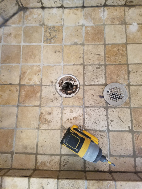 That drain was packed tight! The pan wasn't draining correctly so the natural stone shower floor looked (and was) permanently wet.