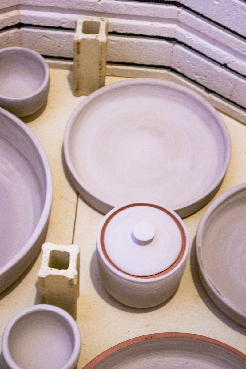Glaze firing oversized speckled bowls in the ceramics kiln | Little Clay Studio, Austin, Texas