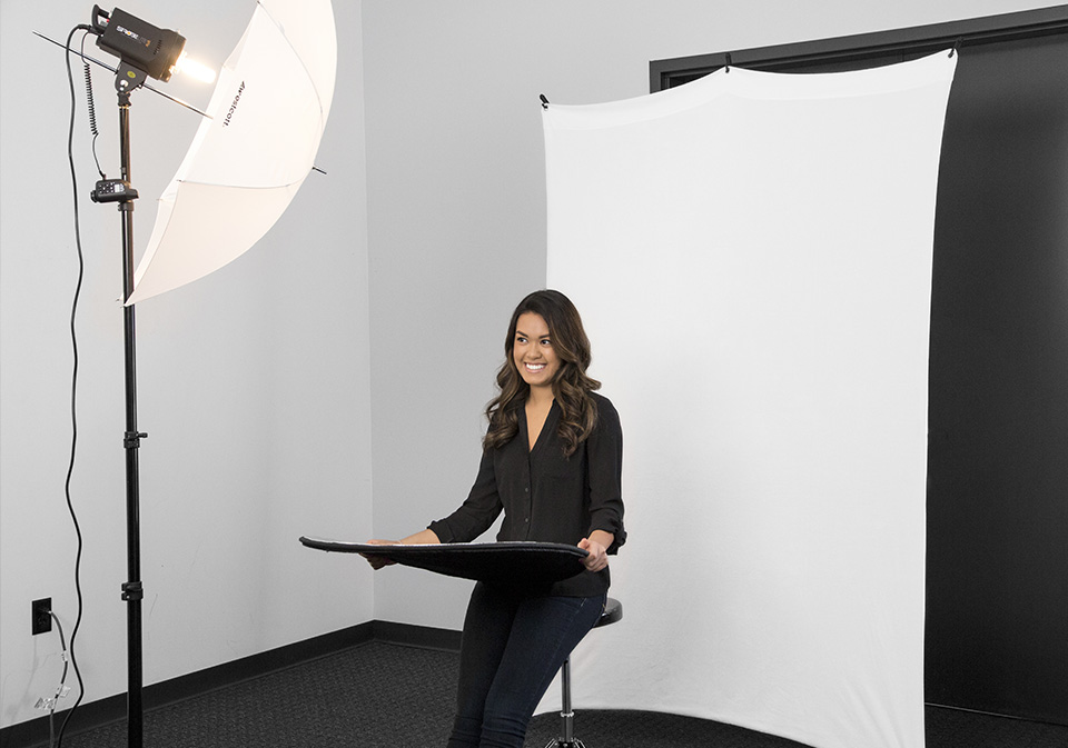 X-DROP SYSTEM - This compact and travel-friendly backdrop support system is designed for portraits, head shots, and video conferencing with an array of 5' x 7' backdrops available.