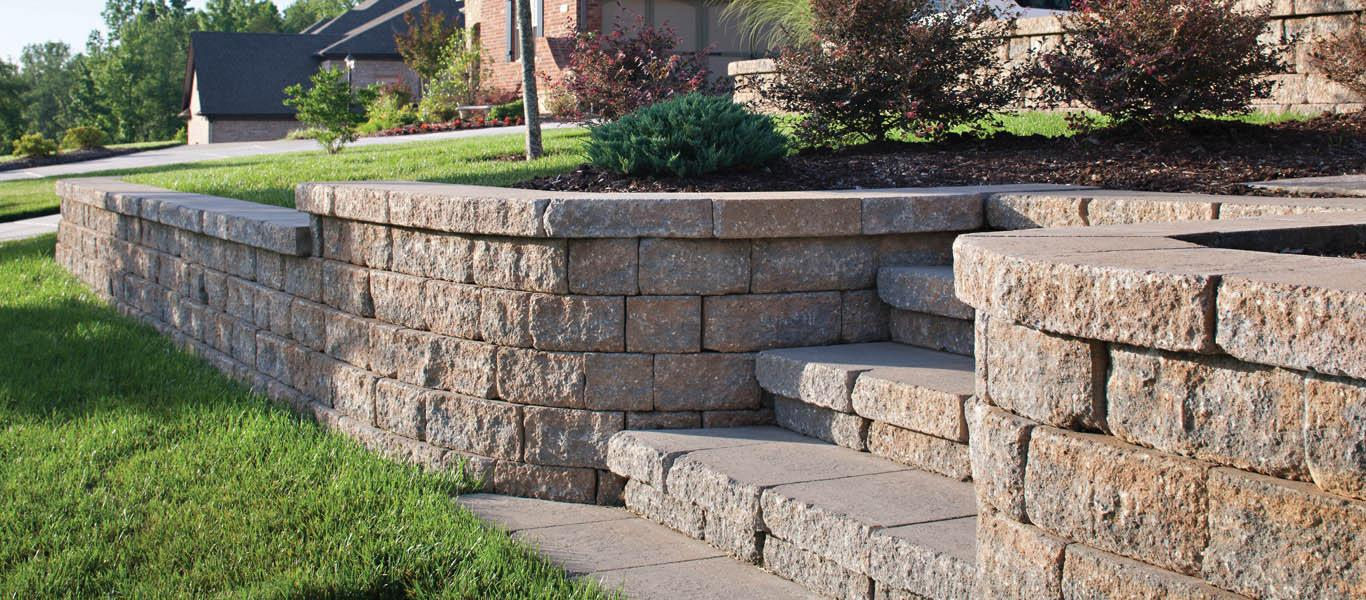 Custom Retaining Wall Design - A Hard working retaining walls can be key to creating a level sports lawn, driveway, or adding a new dimension your home's exterior.