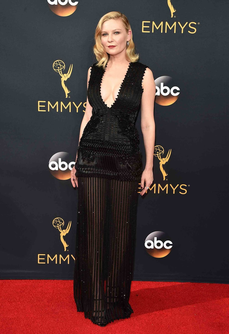 Kirsten Dunst. I love how her outfit--from her hair to her shoes--is 1920s inspired with modern flair.
