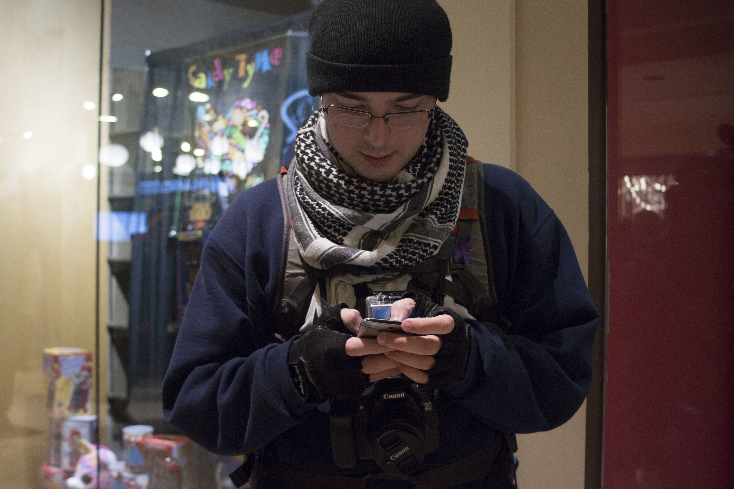 Nelson takes a break from photographing the Black Friday Black Lives Matter protest to tweet about the day's events inside of Westlake Center.