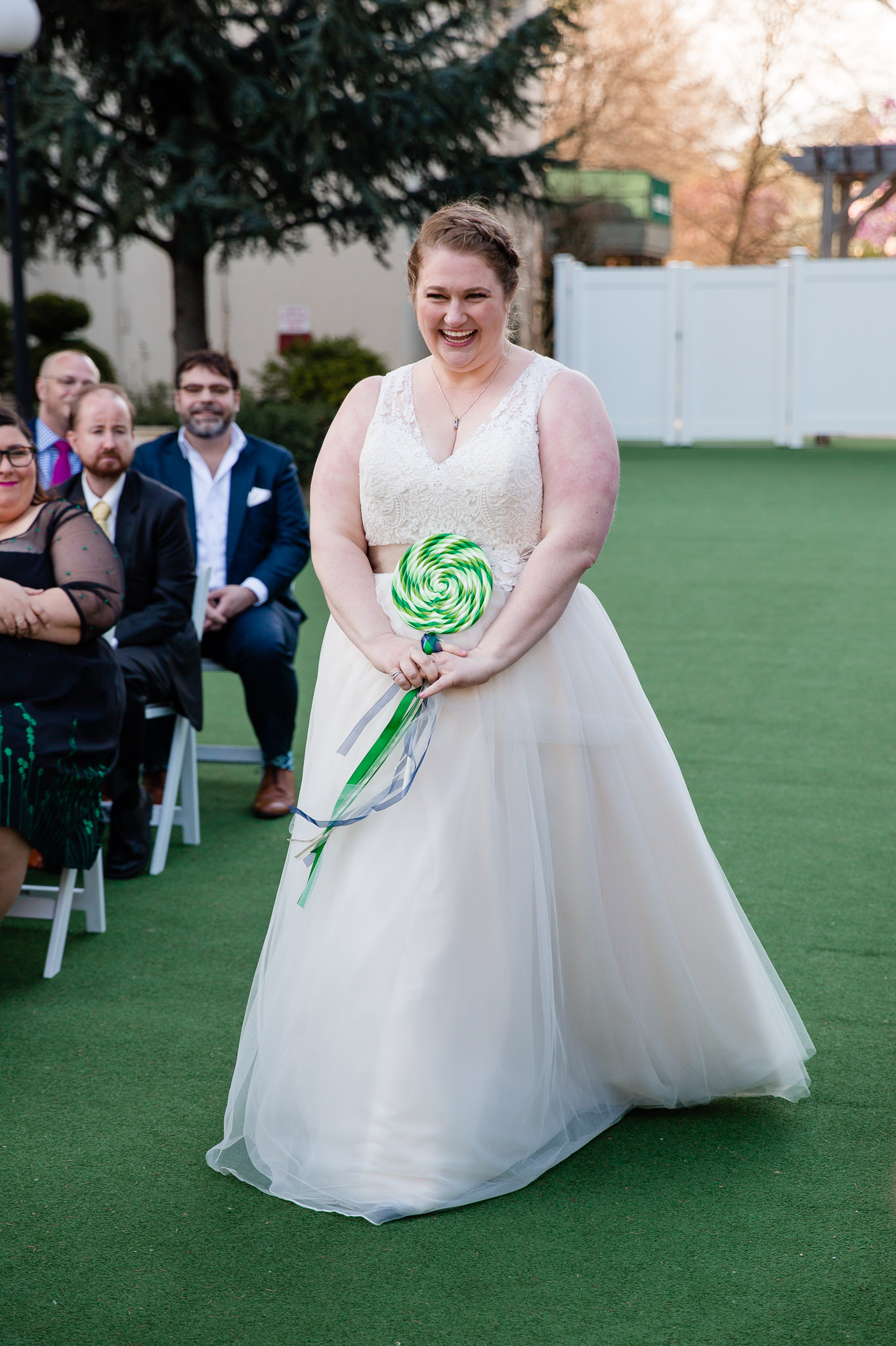 bride walks down the aisle at terrace on the park queens
