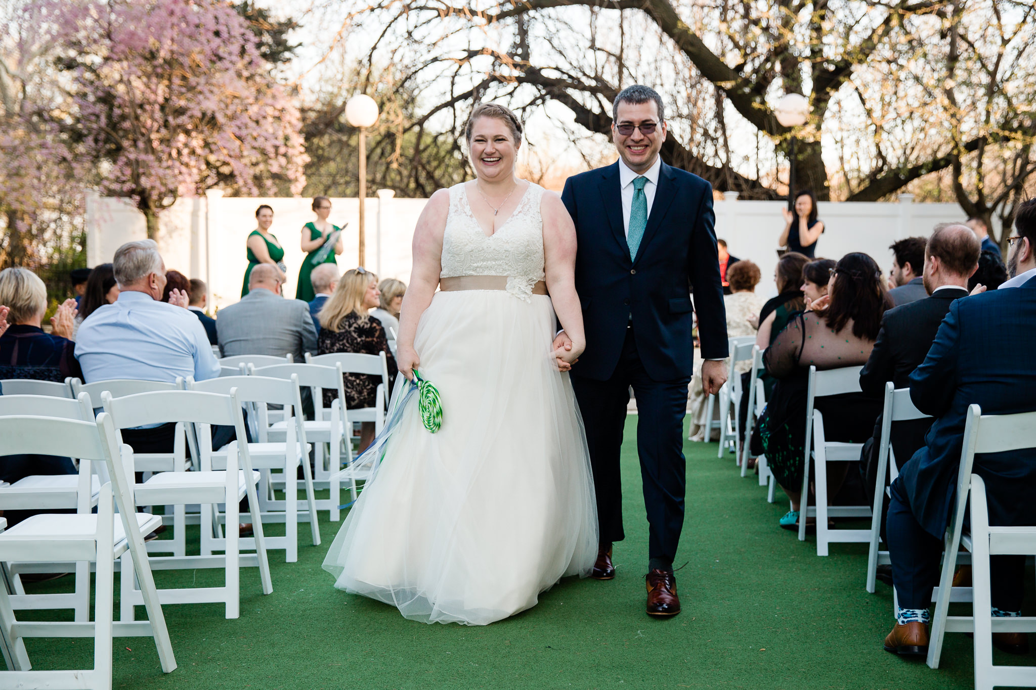 bride and groom recessional at terrace on the park queens new york