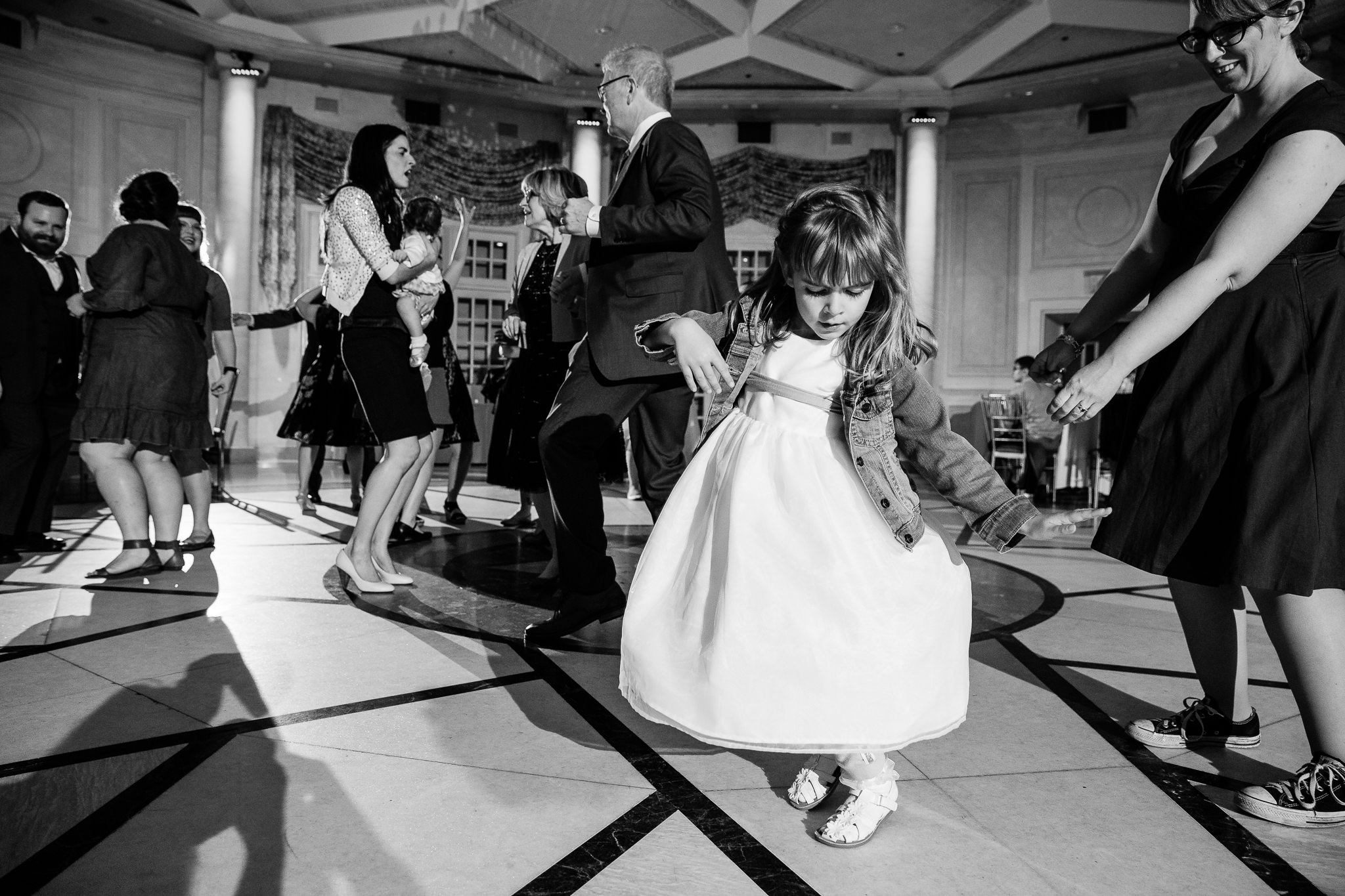 flower girl dances at the reception