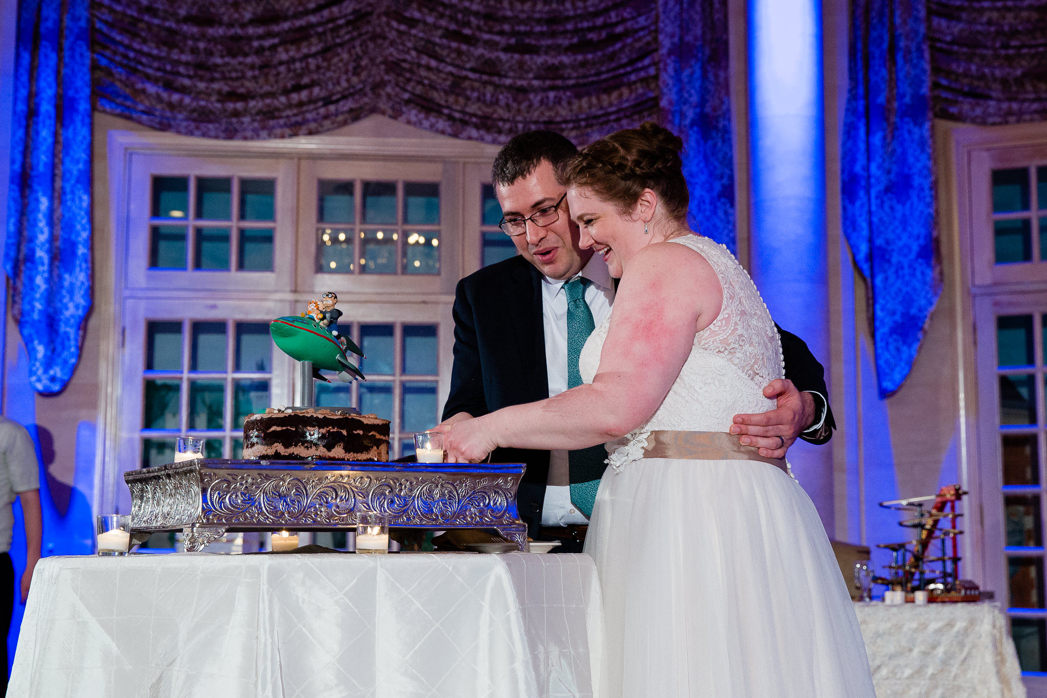 couple cuts momofuku milk bar wedding cake with futurama wedding cake topper