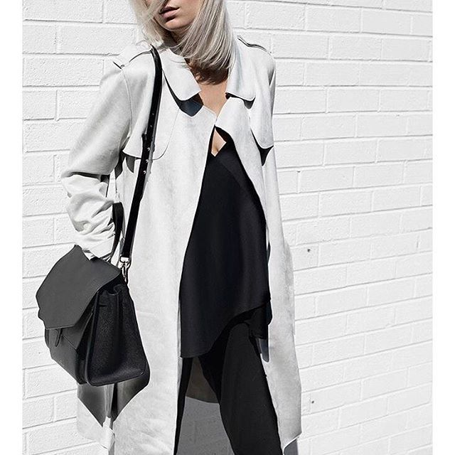 S p o t t e d.  @melo_and_co wearing our extended length Eve Top in black paired with this great trench for cooler days 🖤. I'm really loving this longer version of the top! Email me for ordering information. #love #style #beautiful #fashiondesigner #emergingdesigner #emergingdesigners #devonthomas #alwaysupportalent #fashion #lifestyle #womeninfashion #fashionblogger #influencer