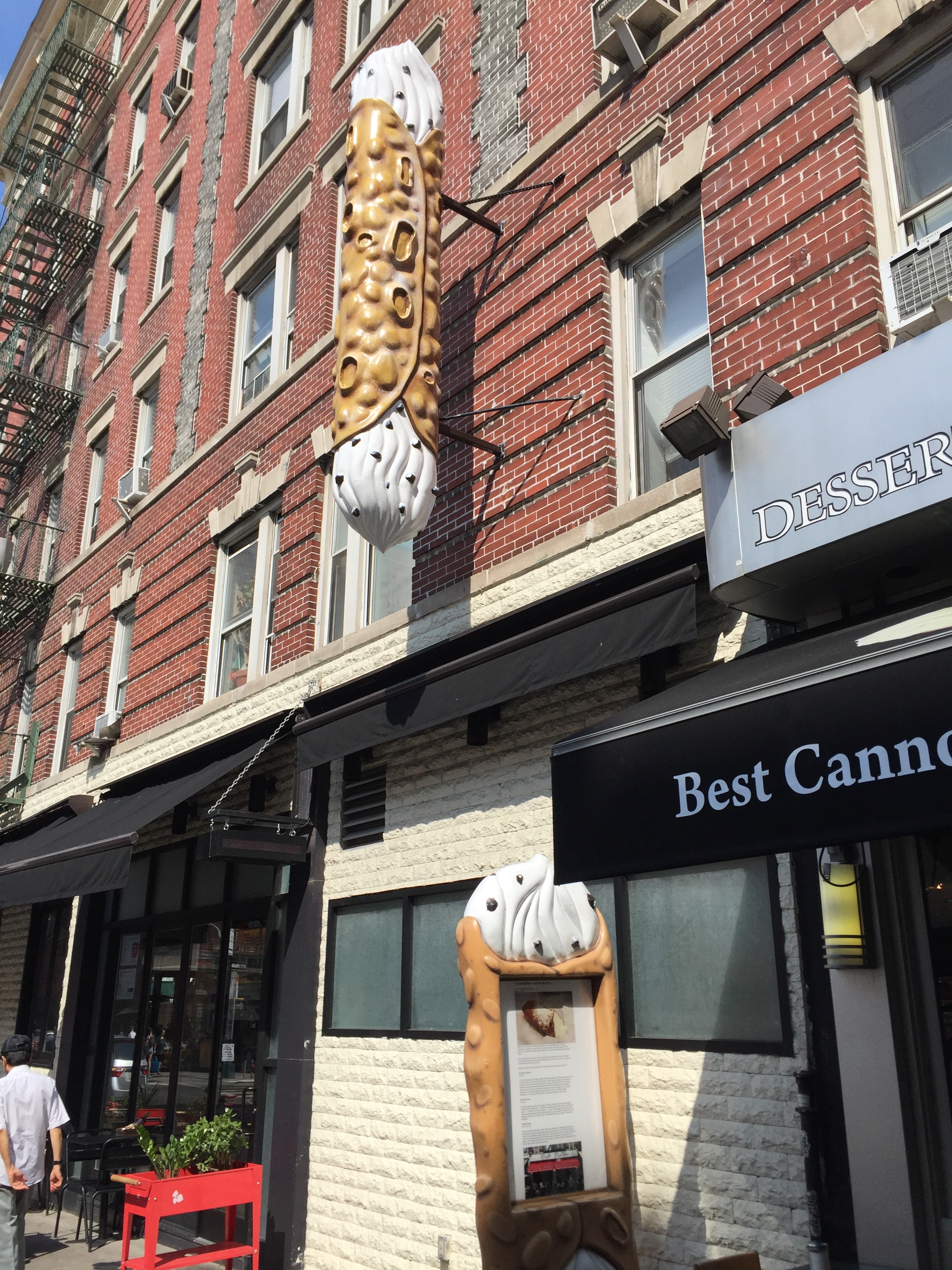 Cannoli sign suspended from building
