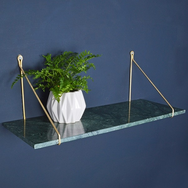 """... perhaps this more realistically priced shelf unit might me a bit more practical after all of the Christmas splurging! Now that green is """"officially in"""" (thanks to Pantone), this stunning marble piece can provide a real showstopping moment to achieve that floating picture shelf we keep meaning to put up."""