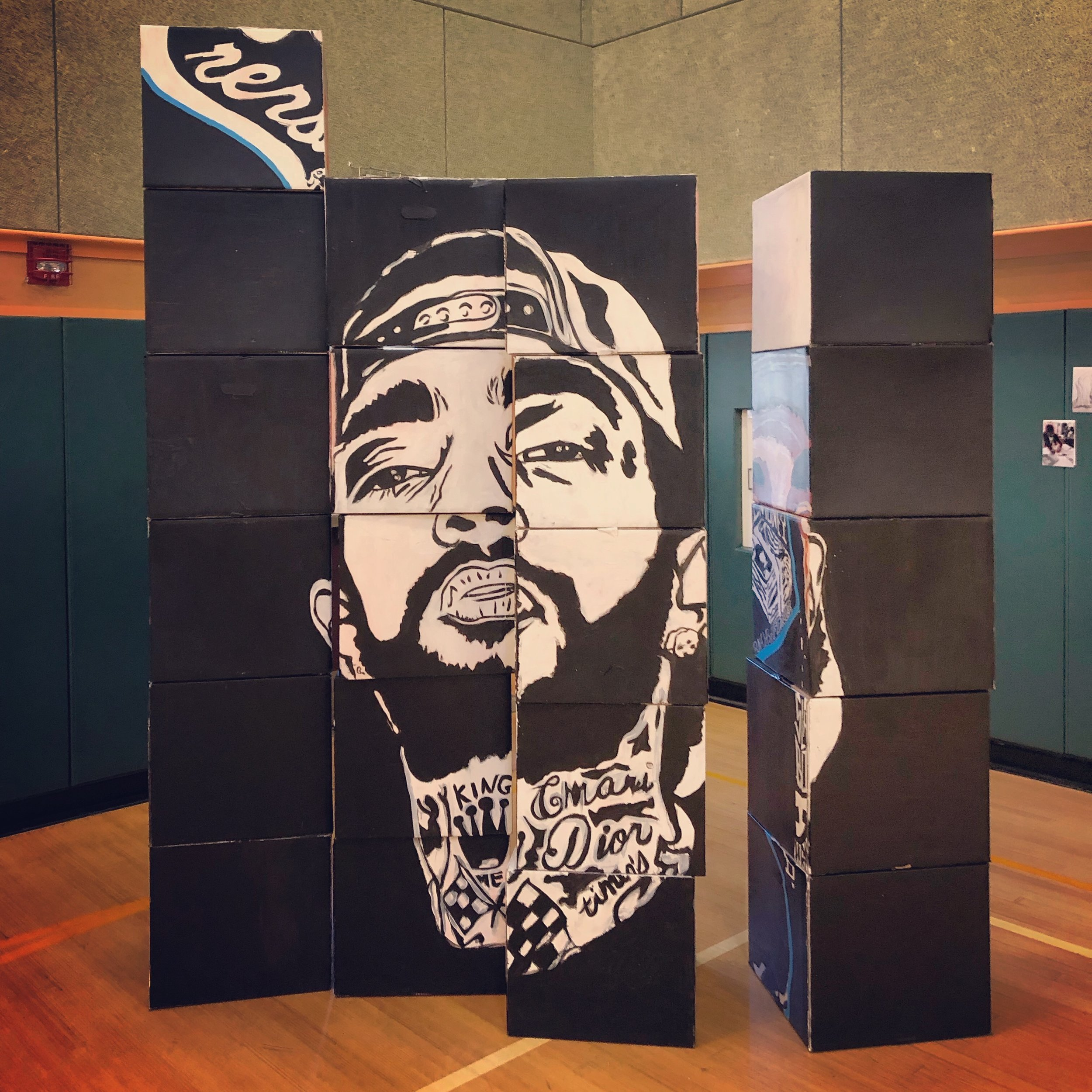 "Another possible iteration of the ""box mural"" made by students from Roses in Concrete Community School."