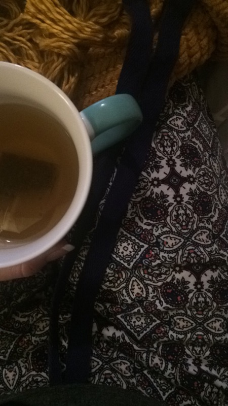 Drinking tea in my cozy pajama pants from Abby + Melissa.