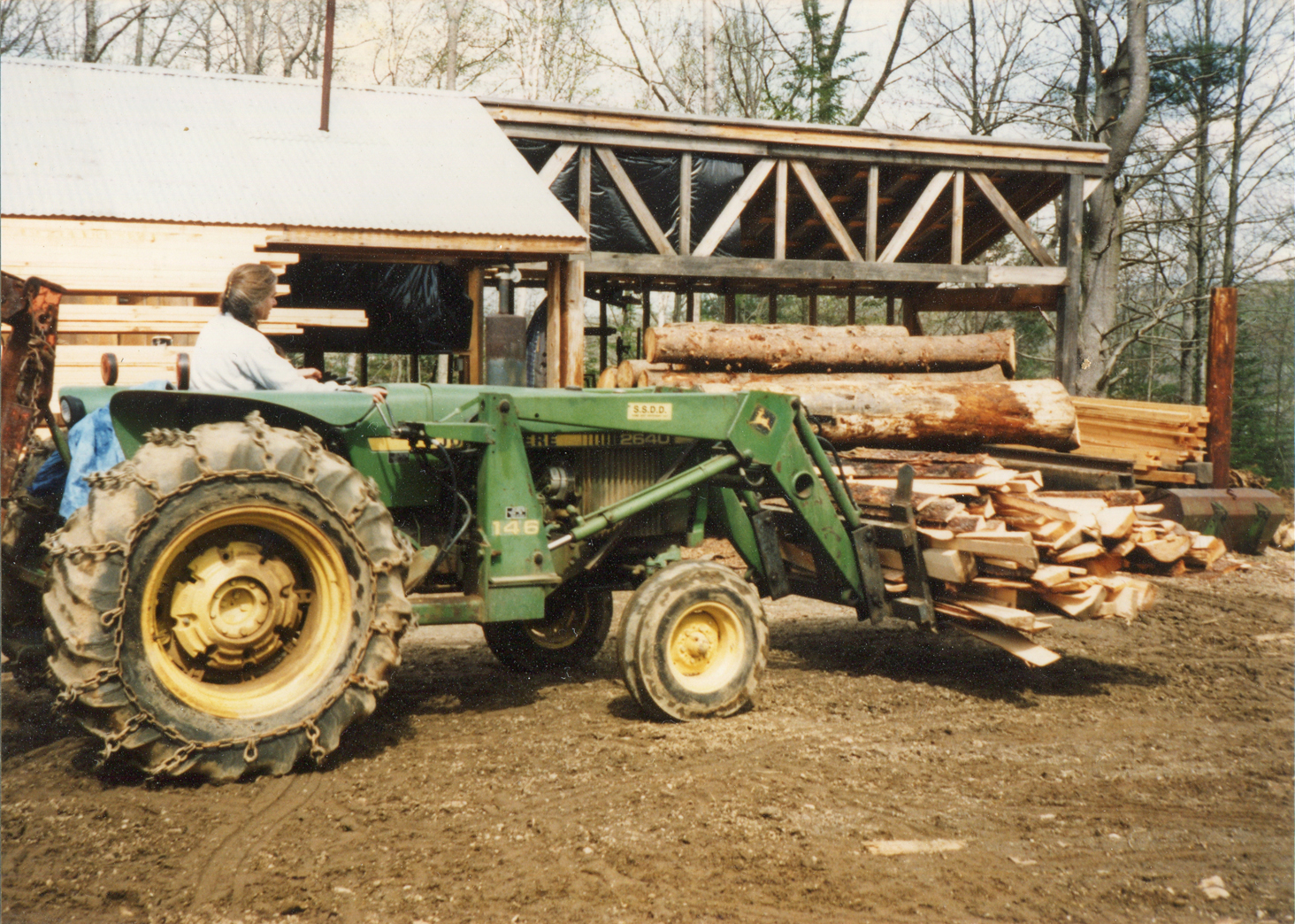 """Ben's parents worked in tandem while their sons were growing up. His mom worked for years as the """"pilot"""" at the mill, piling slabs, stacking boards, and rolling logs—all the while pushing each of her three boys in a swing by her side."""