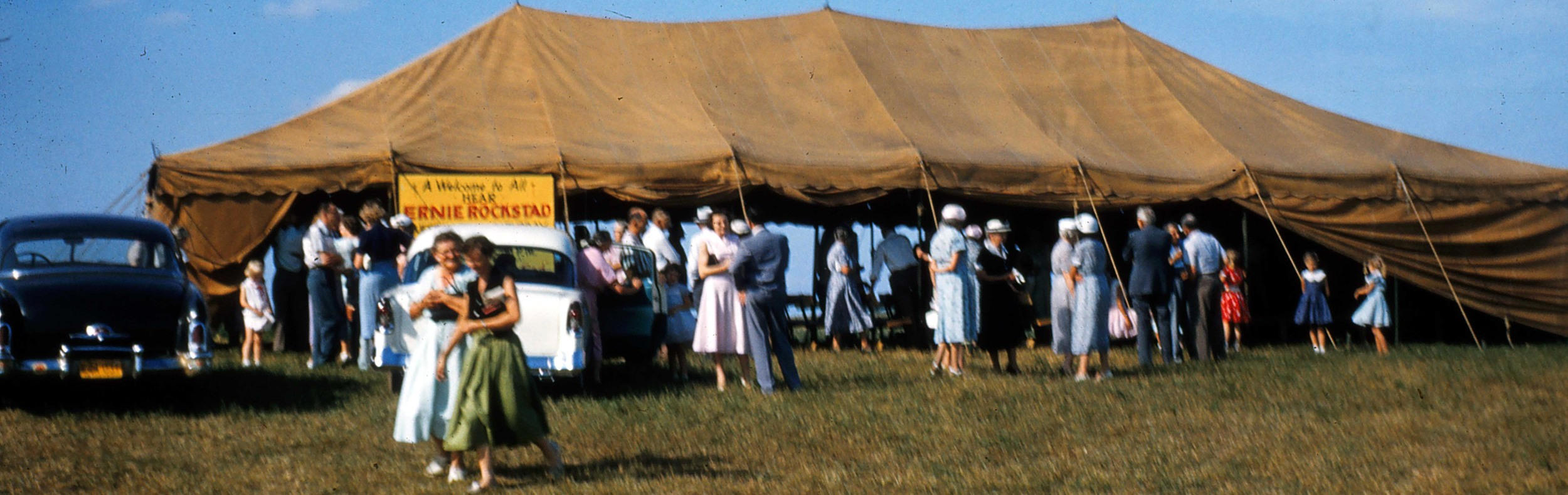 Guests departing after one of Pastor Ernie's many packed tent meetings.