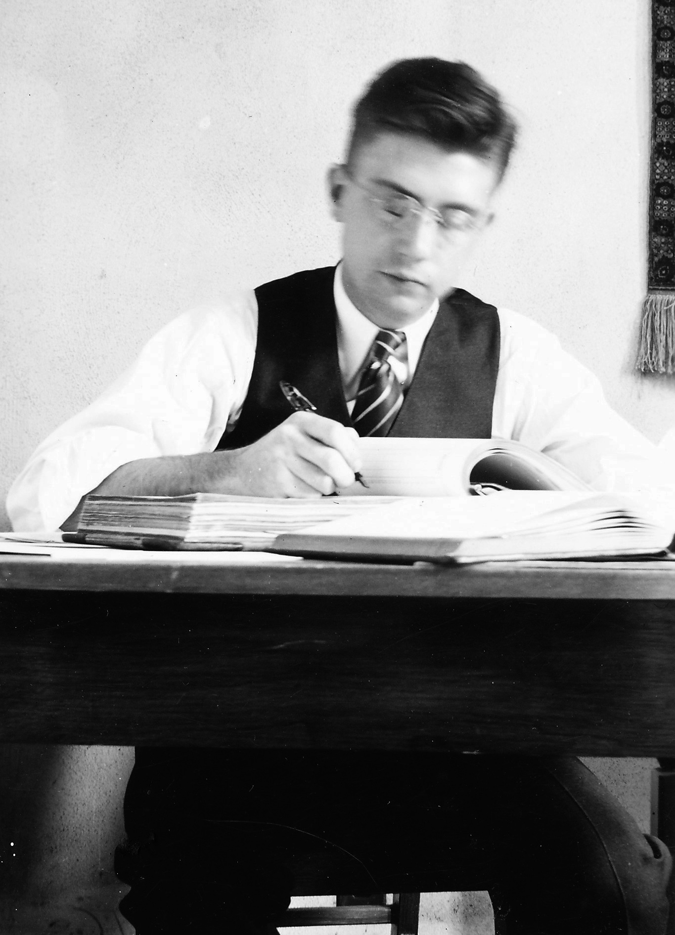 Ernie studying while in college.
