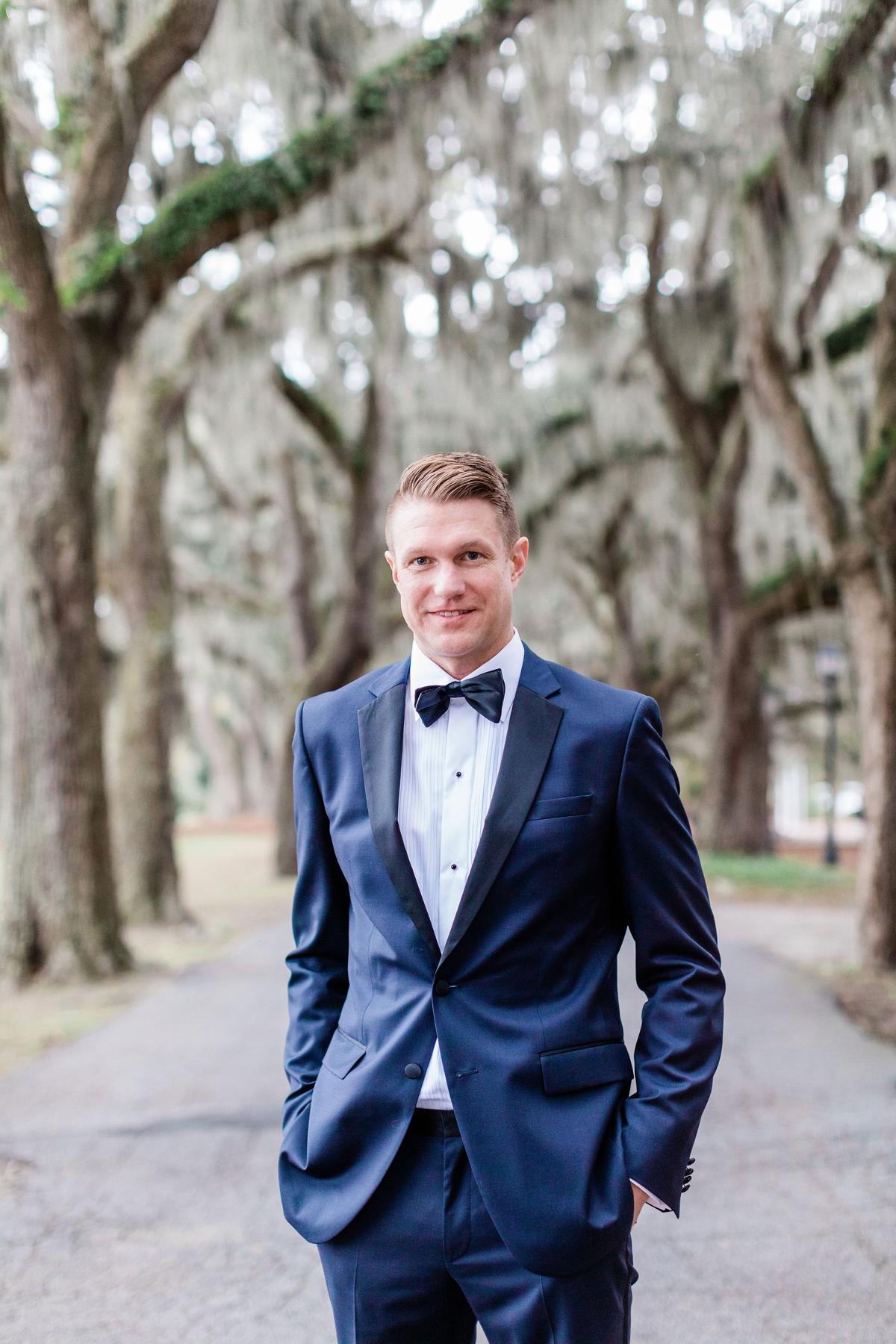 Blue grooms suit with black bowtie - Intimate Savannah Elopement