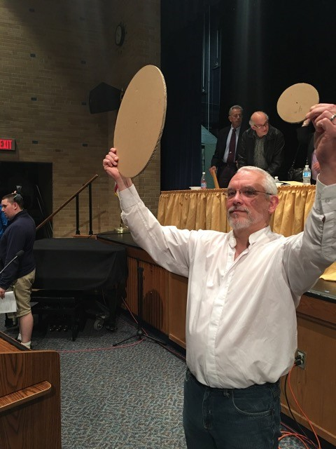 """Anti-pipeline advocate Steve Fishman demonstrating the size difference between an average residential distribution pipeline versus the proposed 16"""" high pressure transmission pipeline."""