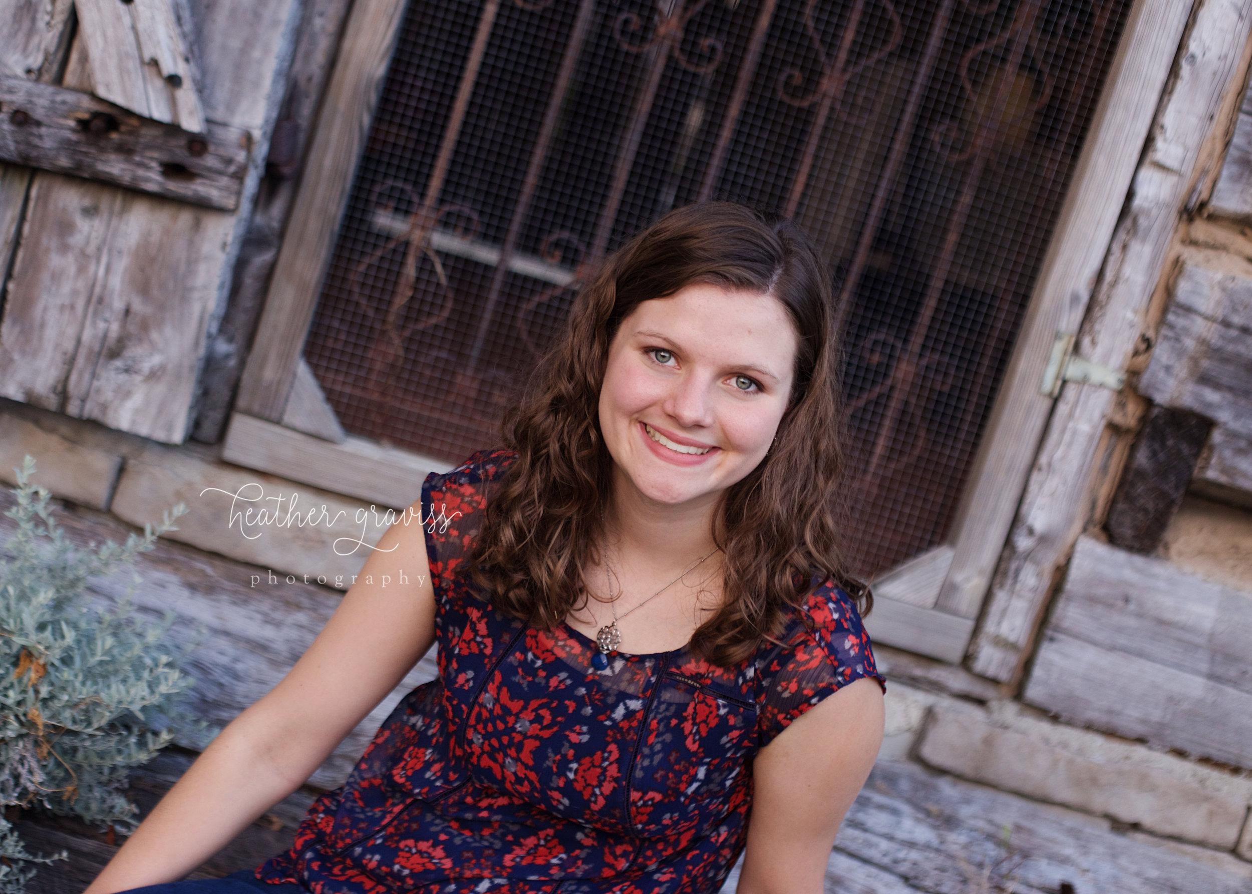 senior-girl-at-cabin.jpg