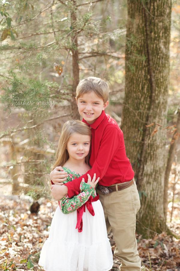 hugging-siblings-in-woods.jpg