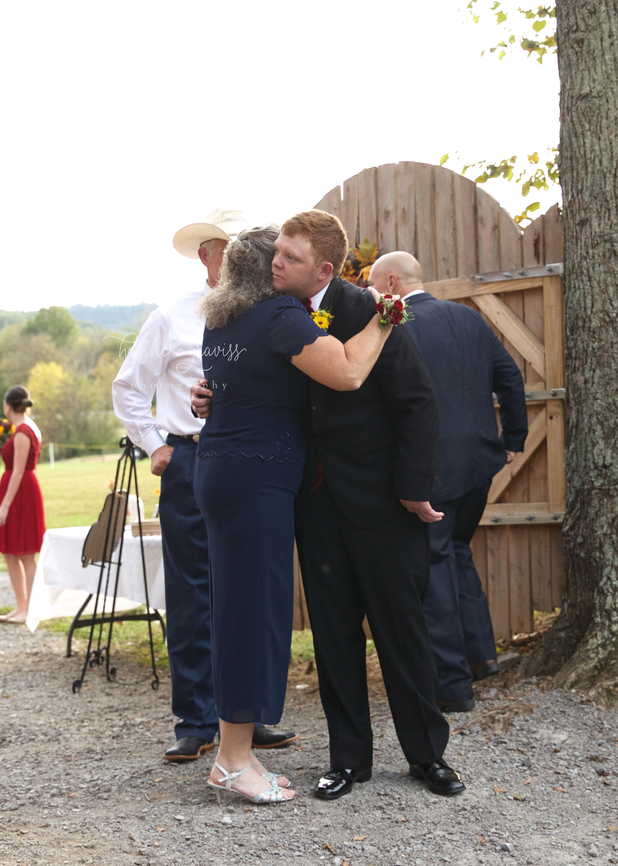 38 groom-getting-hugged-by-mother.jpg