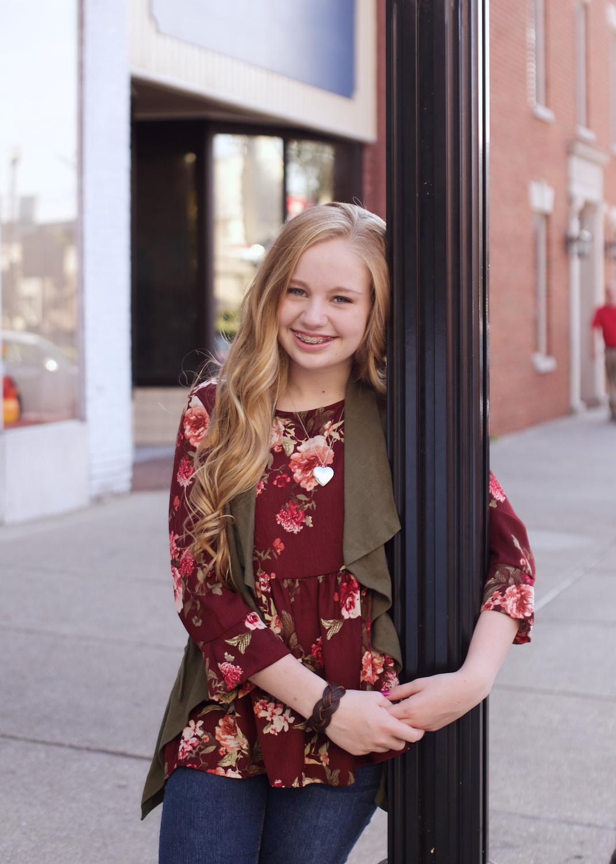 teen-girl-leaning-on-lightpost.jpg