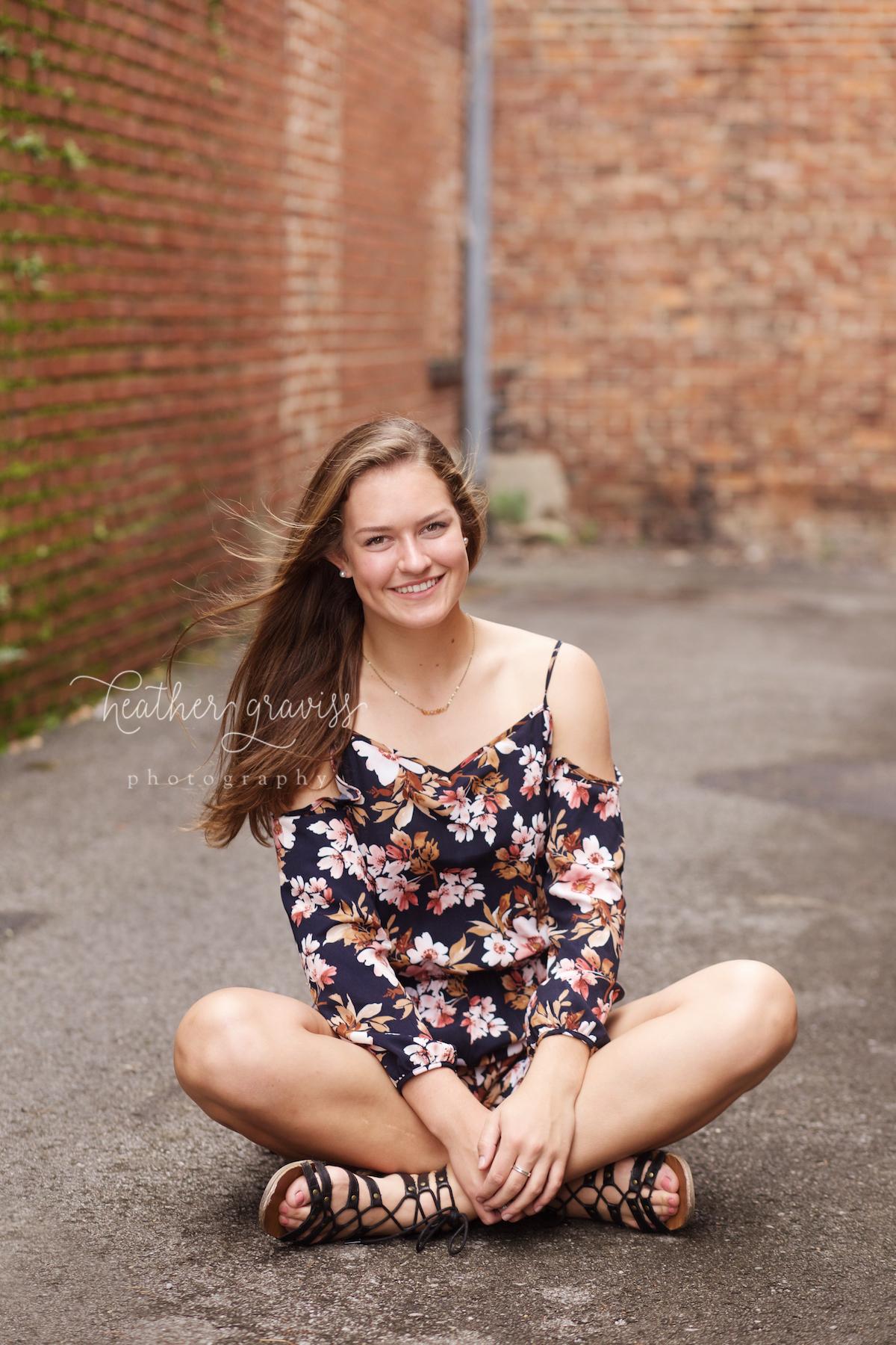 sitting-girl-in-floral-jumper.jpg