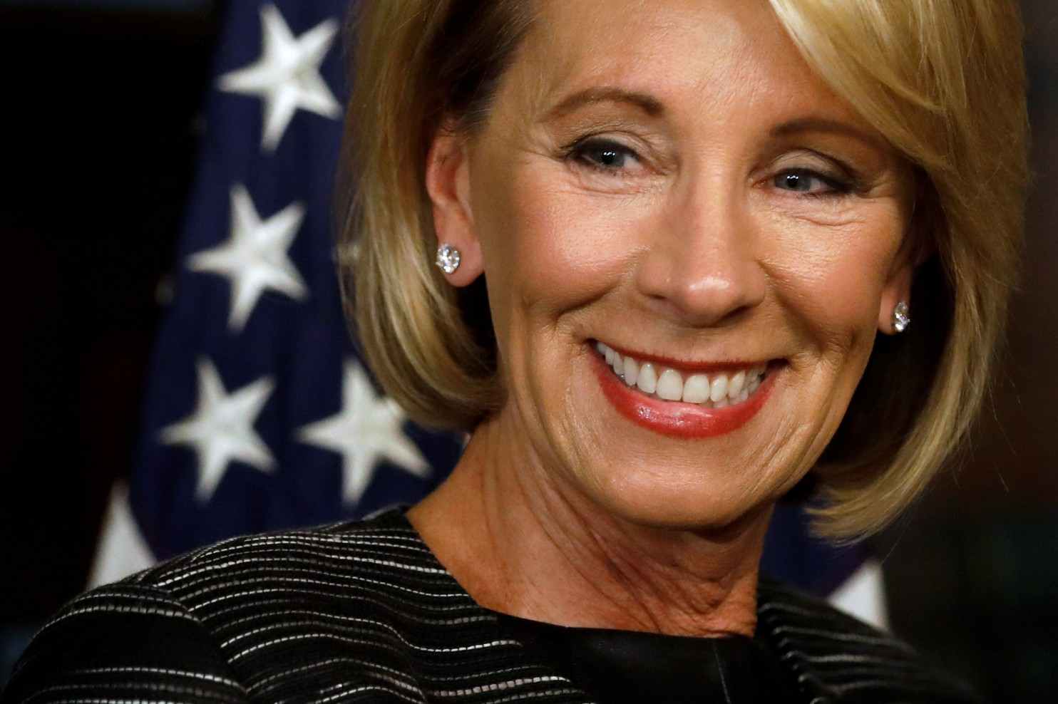 """(Jonathan Ernst/Reuters) """"DeVos pledged in a nine-minute speech to challenge the Education Department to examine its policies and practices — and to listen to her new colleagues."""" – Washington Post's Emma Brown"""