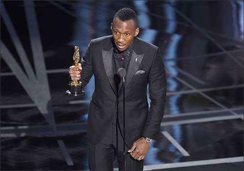 """Mahershala Ali accepts the award for best actor in a supporting role for """"Moonlight"""" at the Oscars on Feb. 26, in Los Angeles. Photo by Chris Pizzello/Invision/AP"""