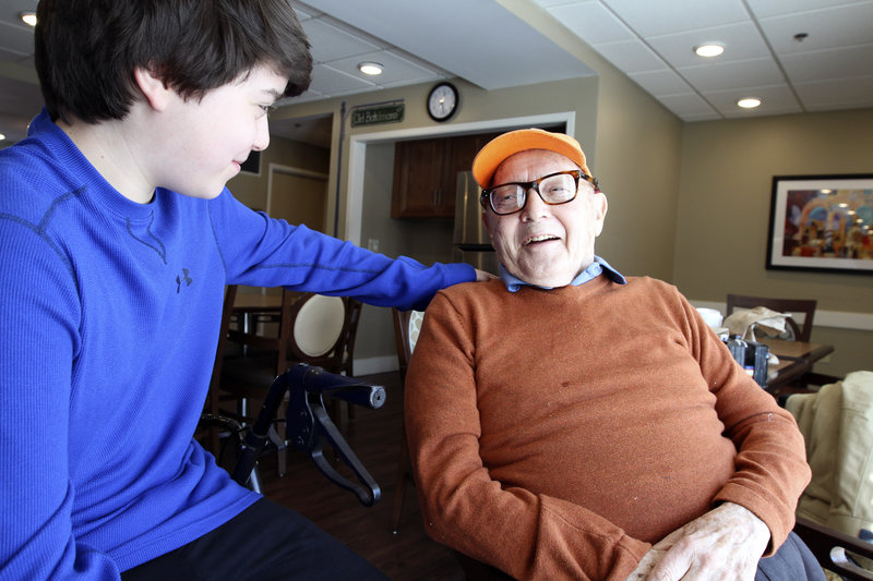 Paul Miller shares a joke with his grandson, Max. They play poker together, but as a numbers guy, Miller is hard to beat.  LA Johnson/NPR