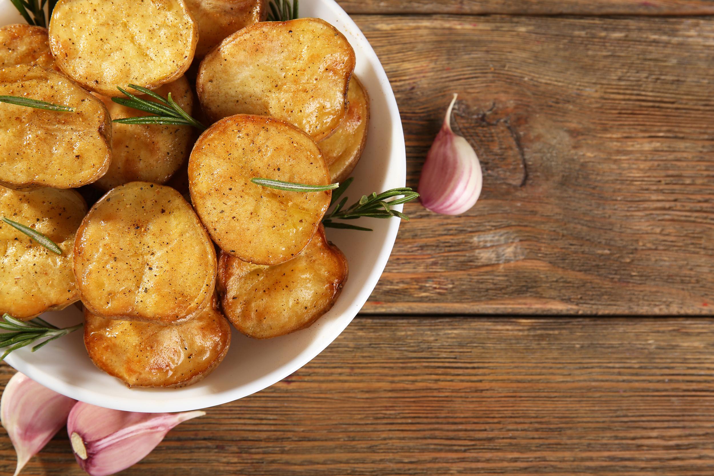 bigstock-Delicious-baked-potato-with-ro-111085997.jpg