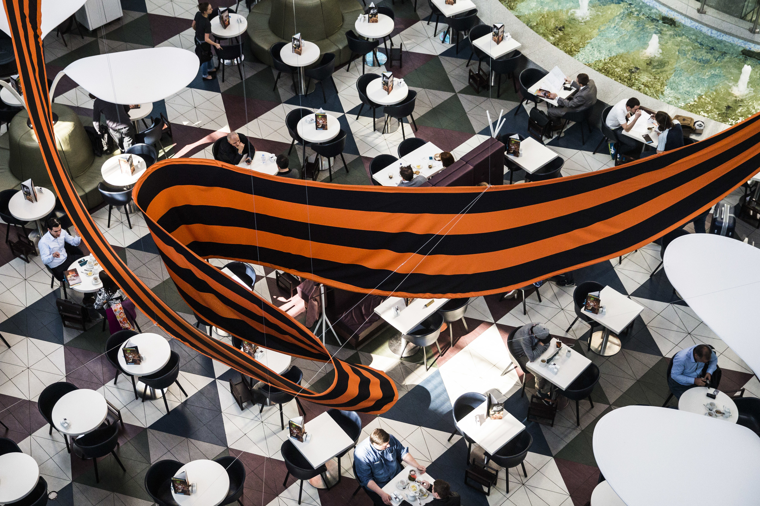 Giant St.George's ribbon flies over a cafeteria in a mall in Moscow a week before Russia celebrated the Victory Day that the ribbon is a symbol of for last years