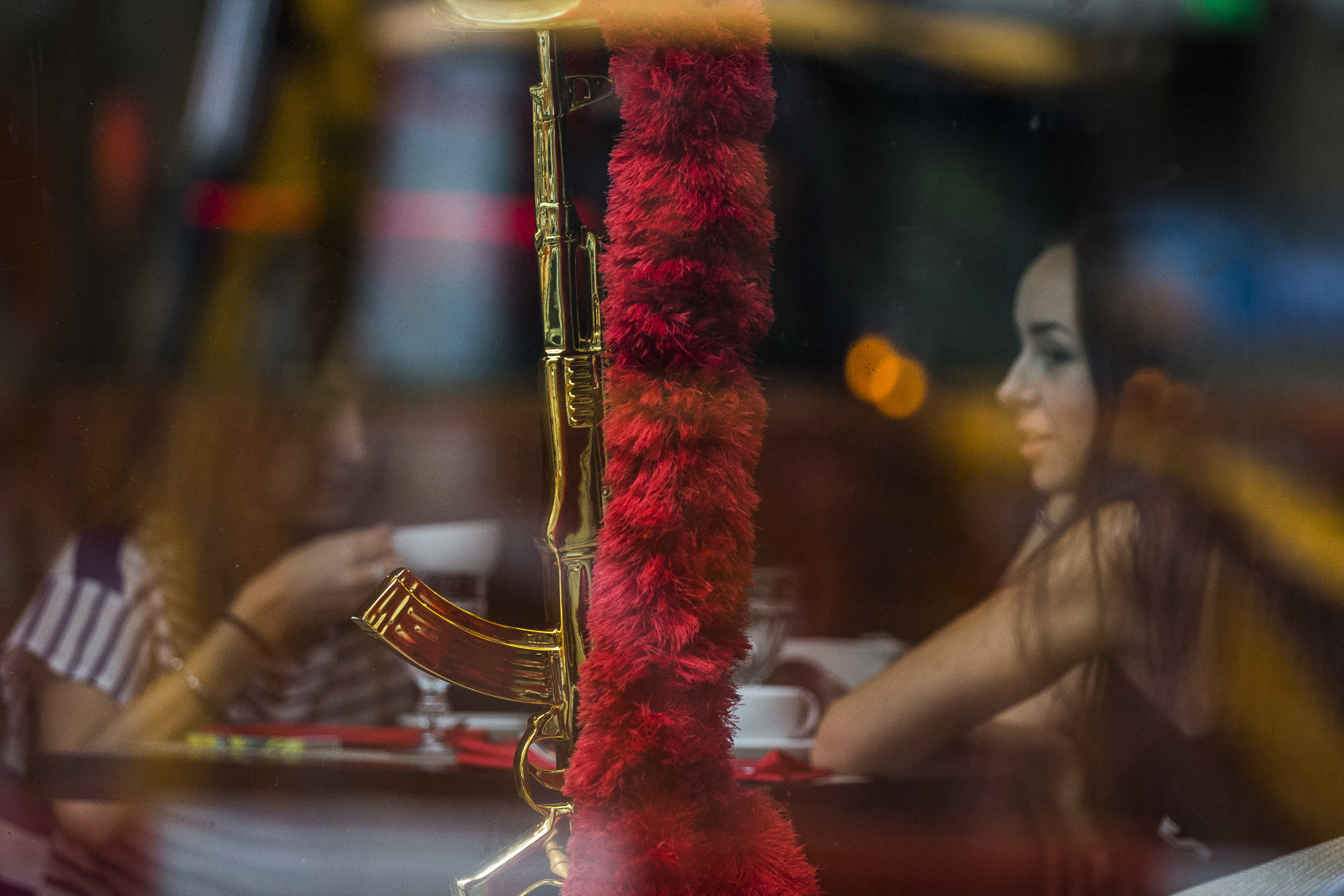 """A golden kalyan in aform of an AK assault rifle that is seen in a window of """"#Sanctions bar"""" in Moscow that was opened after Western countries imposed sanctions against Russia and is using all sorts of patriotic symbols"""